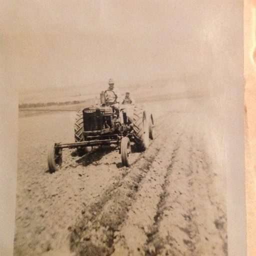 Then: Our grandfather on our Farmall H
